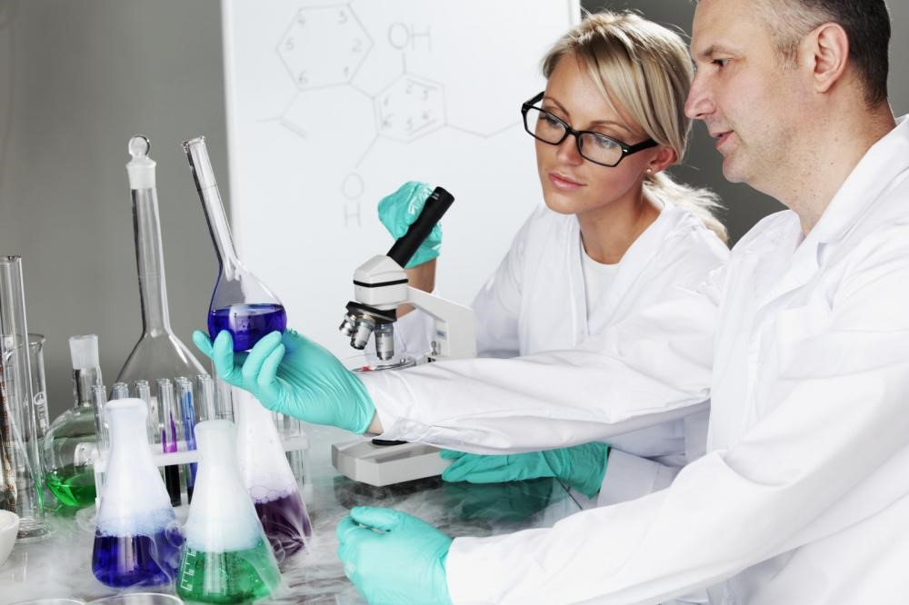 Researchers studying new drug compounds in a lab