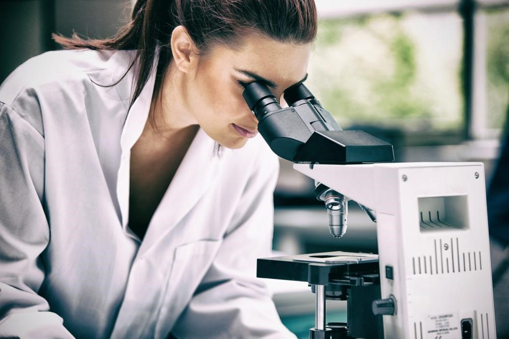 Researcher studying new drug compounds in a lab