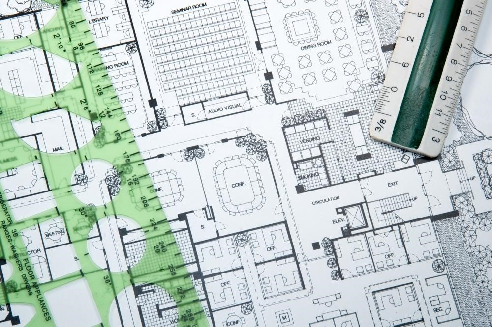 blueprint for an architect, representing the need to design a development plan
