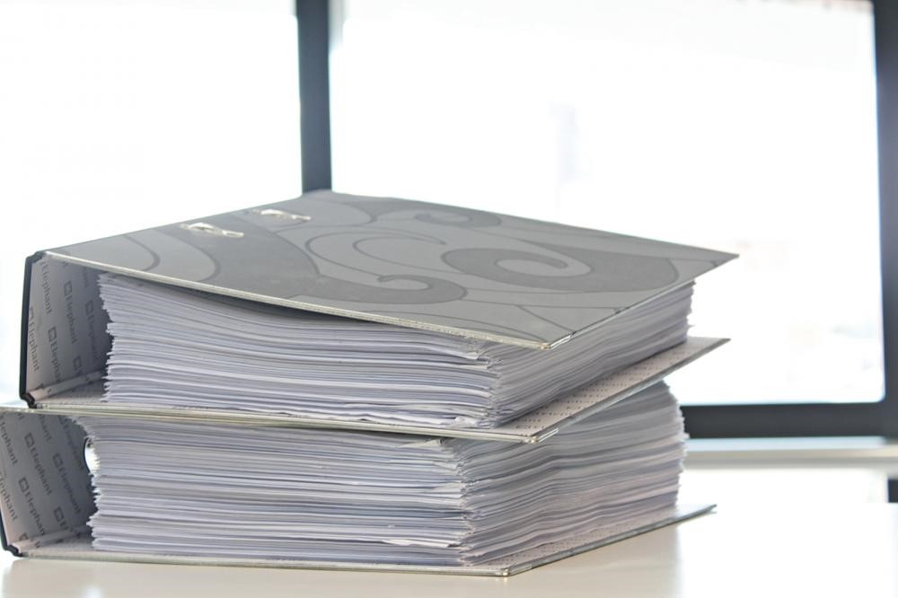 binder folders representing research and paperwork for preclinical studies